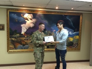 140 - William receiving a gratitude plaque from the Base Commander in SW Asia