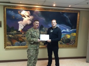 141 - Murdock receiving a gratitude plaque from the Base Commander in SW Asia