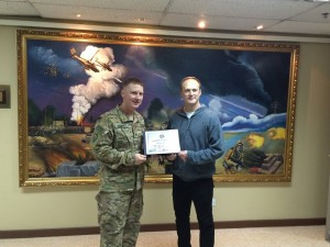142 - Oliver receiving a gratitude plaque from the Base Commander in SW Asia