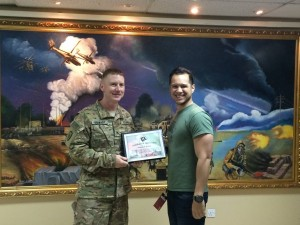 143 - Josh receiving a gratitude plaque from the Base Commander in SW Asia