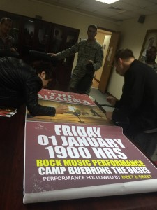 197- Signing  posters for the officers at Camp Buehring, Kuwait.