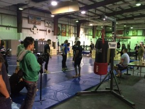 239 - Watching the MMA fighters do their workshop for the troops.  They were egging us on to spar. Aiiiin't no way ya'all! :D — at Camp Arifjan Kuwait.
